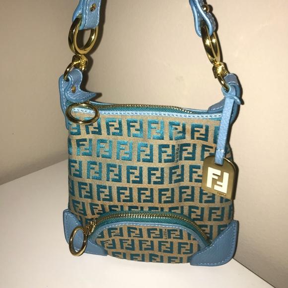 518727ebd79f Fendi Handbags - Authentic fendi blue zucca pochette clutch